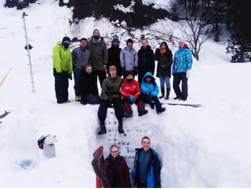Groups of students dig snow horizon for snow sampling