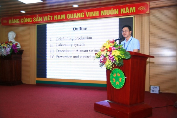 Dr. Nguyen Van Long, Department of Animal Health, presents at the conference
