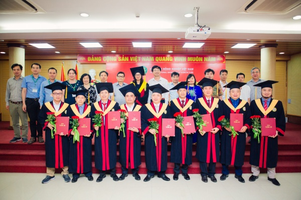 New PhD holders with VNUA's President and lecturers